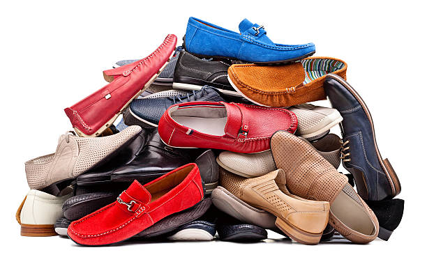 Pile of various men shoes isolated over white, with clipping path